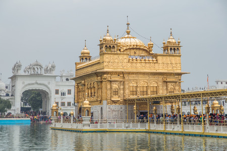 gurdwara: AMRITSAR, INDIA - 01 MARCH 2015: Pilgrims at Golden Temple, the holiest Sikh gurdwara in the world. Editorial