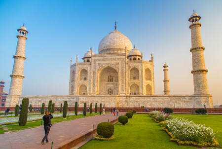 love dome: AGRA, INDIA - 28 FEBRUARY 2015: View of Taj Mahal towards South side. Visitor with camera.