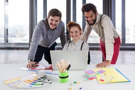brain storming: Business people in modern office posing for camera. Stock Photo
