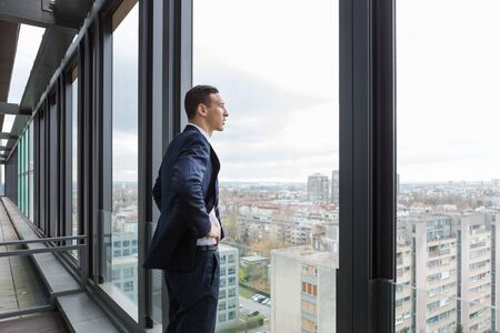 Business man looking out through the office balcony. Stok Fotoğraf