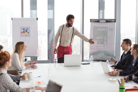 brain storming: Hipster business man presenting the project in modern office.