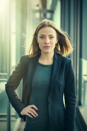 woman business suit: Portrait of young attractive business woman in the office. Post processed with vintage filter.
