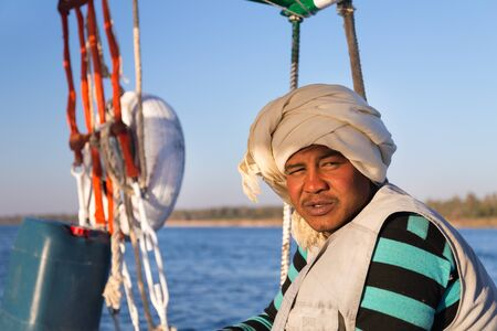 sailing crew: EGYPT -  FEBRUARY 9, 2016: Portrait of Nubian felucca sailing crew man on trip on the Nile.