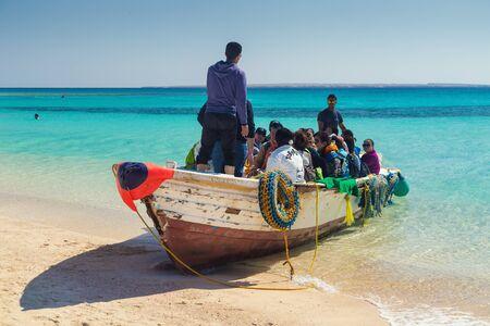island paradise: PARADISE ISLAND, EGYPT - FEBRUARY 12, 2016: Tourists at the beach taking of the boats.