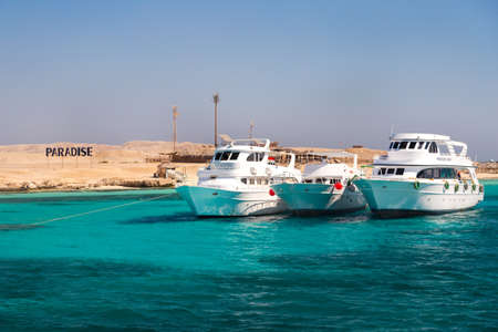 hurghada: HURGHADA, EGYPT - FEBRUARY 12, 2016: Boats docked at Paradise Island.