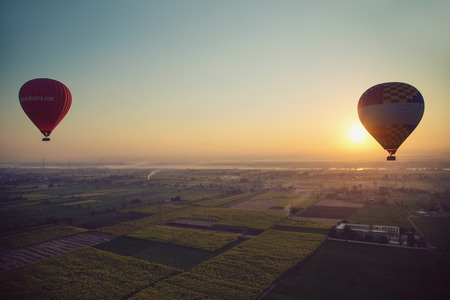 ballooning: Hot air ballooning  over the Valley of the Kings and Nile river. Editorial