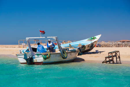 boat crew: PARADISE ISLAND, EGYPT - FEBRUARY 12, 2016: Boat crew waiting for the tourists at the beach. Editorial