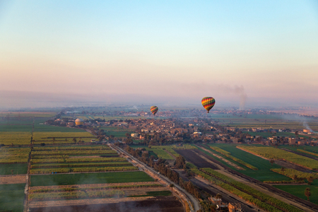 nile river: Hot air ballooning  over the Valley of the Kings and Nile river. Stock Photo