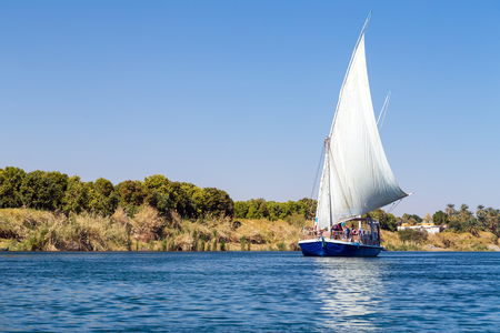 the nile: Felucca, traditional wooden sailboat on shore of Nile, Egypt.