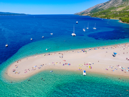 sunbath: Aerial view of Zlatni rat beach in Bol, Island Brac, Croatia Stock Photo