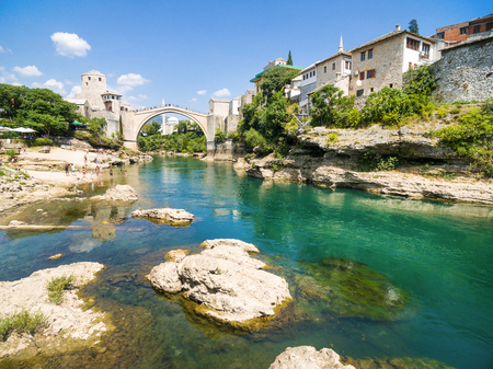 People at Old Bridge over Neretva river in Mostar, Bosnia and Herzegovina. Stock Photo