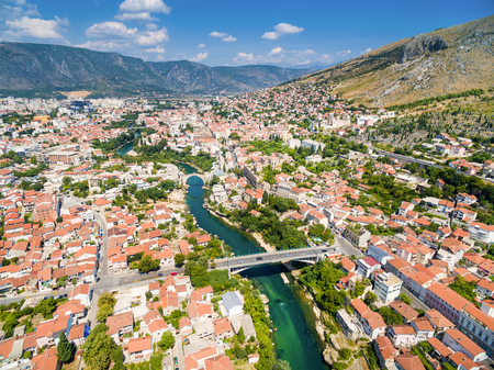 Aerial view of city of Mostar in Bosnia and Herzegovina and its landmarks (Neretva river, Old bridge, Koski Mehmed Pasha Mosque).
