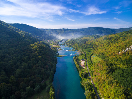 myst: Aerial view of  Una river surrounded by forest and hills, Bosnia and Herzegovina.