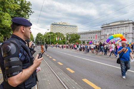 securing: ZAGREB, CROATIA - JUNE 11, 2016: 15th Zagreb pride. Intervention policemen in front of Mimara museum securing LGBTIQ activists and supporters during the gay pride. Editorial