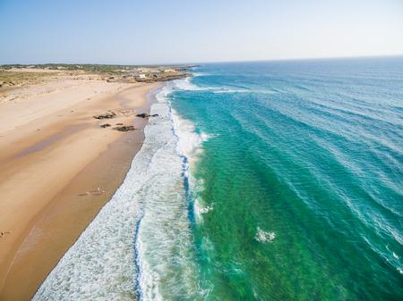 drapeau portugal: Praia da Guincho beach Portugal, popular with kitesurfers