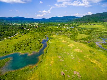 uninhabited: Aerial view of Jesenica river and surrounding in Croatian region Lika. Stock Photo