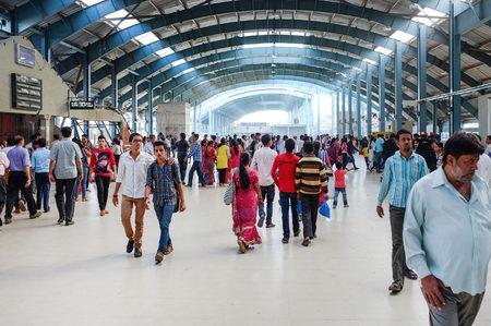 MUMBAI, INDIA - JANUARY 2015: People walking through interior passageway at train station.