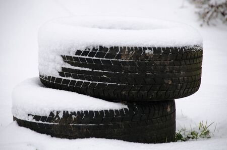 feastive: Old Tyres stacked in the snow