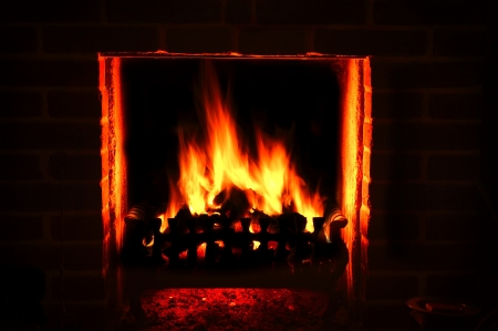A warm roaring fire in a brick fire place photo