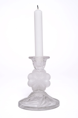 White Candle in a Glass Candlestick Holder.