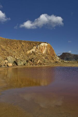 open pit mine with contaminated water photo