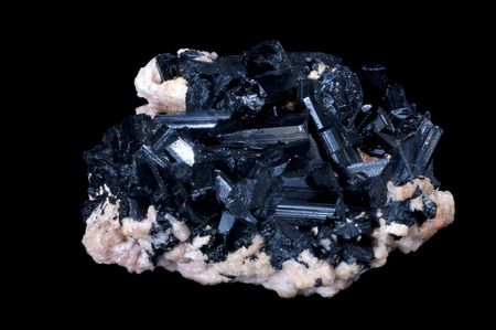 vitreous: black tourmaline stone in a black isolated background Stock Photo