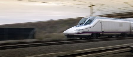 High speed train in blurry motion near Cordoba Station in Spain