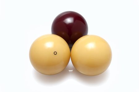 poolball: three billiard balls real ivory, two white and one red  isolated