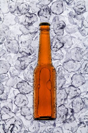 beer on ice cubes fragmented in horizontal photo