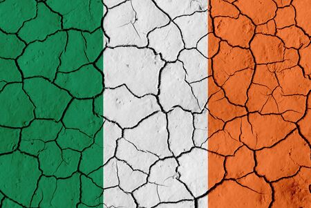 Flag of Ireland over cracked background, conceptual image of crisis photo