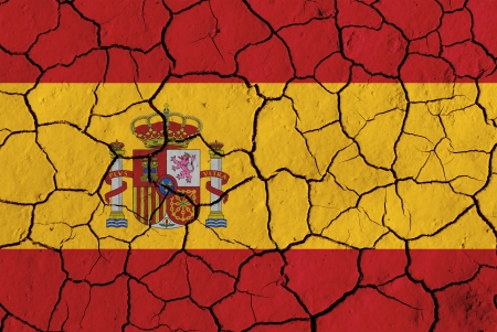 flag spain: Flag of Spain over cracked background, conceptual image of crisis Stock Photo
