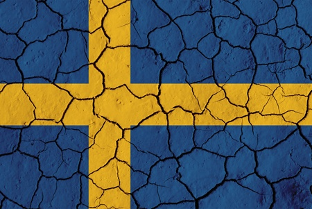 Flag of Sweden over cracked background, conceptual image of crisis photo