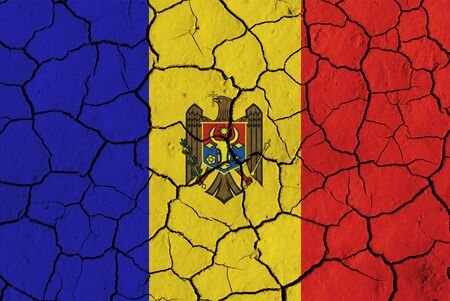 moldovan: Flag of Moldova over cracked background, conceptual image of crisis Stock Photo