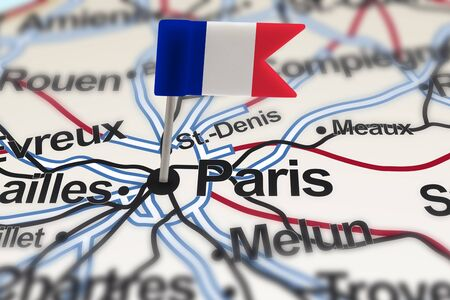pin with flag of France in Paris with selective focus photo