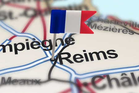 pinned: pin with flag of France in Reims with selective focus