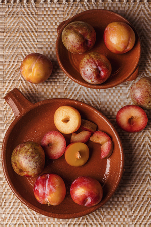 Plums pieces in wood table