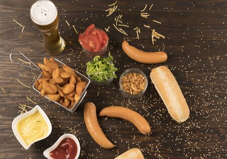 Sausages with various seasonings on wooden board Banco de Imagens