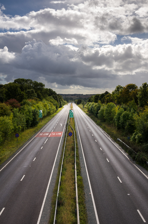 carriageway: A dual carriageway (North American English: divided highway) is a class of highway with dual carriageways for traffic travelling in opposite directions separated by a central reservation (North American English: median).