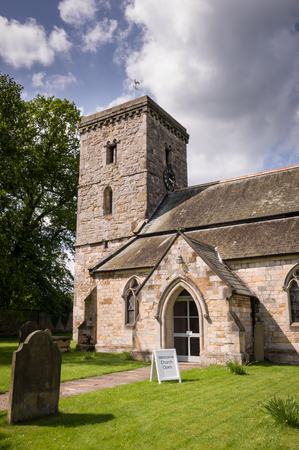 all weather: All Saints Church - Village of Hovingham, North Yorkshire, England, the home of the Worsley family and the childhood home of the Duchess of Kent