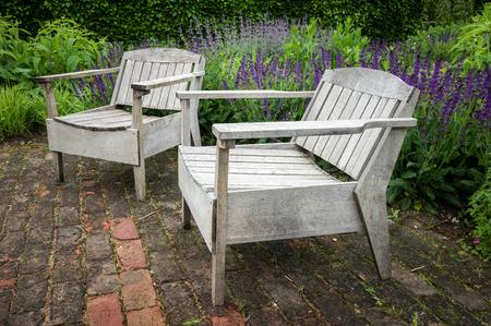 english oak: Unusual oak wood Garden Seats in a formal English garden setting.