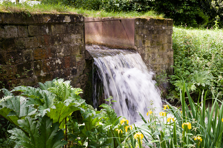A weir ?w??r is a barrier across a river designed to alter its flow characteristics.