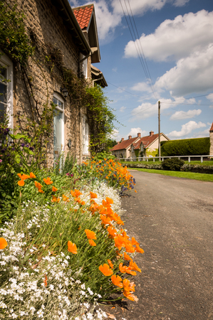 Village of Hovingham, North Yorkshire, England, the home of the Worsley family and the childhood home of the Duchess of Kent Stock Photo