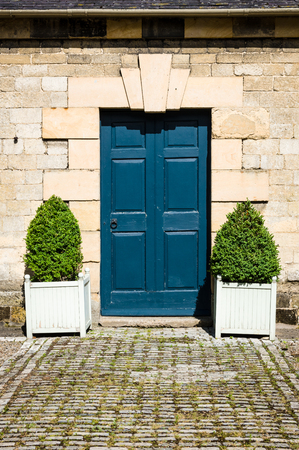 period: Small period door with clipped box shrubs Stock Photo