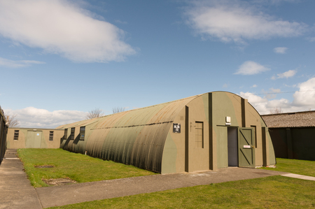 corrugated steel: A Nissen hut is a prefabricated steel structure, made from a half-cylindrical skin of corrugated steel.