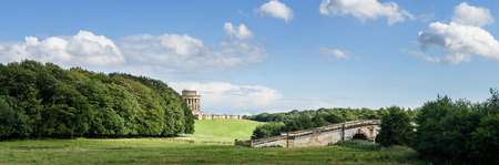 north yorkshire: The Mausoleum and New River Bridge on a hot summers day, Castle Howard, North Yorkshire.