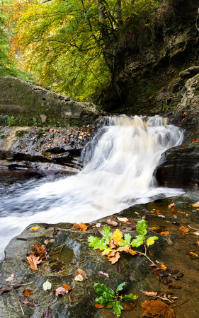 Small waterfall at Skelton Beck, North Yorkshire. remains of the old mill concrete dam can still be seen too.