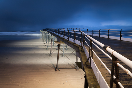 winter storm: Saltburn Pier with approaching winter storm