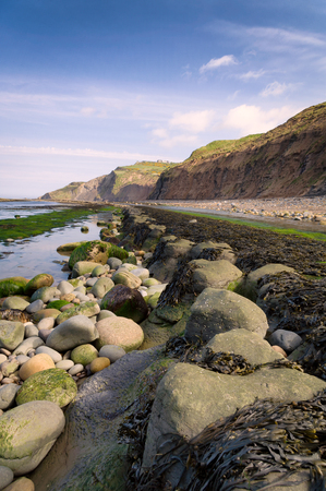 coastal erosion: Boggle hole near Robin Hoods Bay, North Yorkshire, UK. Stock Photo