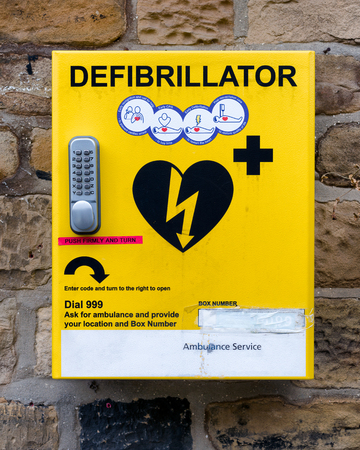 Cardiac Arrest: A defibrillator is a device that gives a high energy electric shock to the heart through the chest wall to someone who is in cardiac arrest.