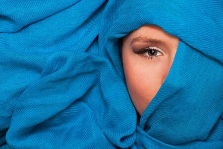 young beautiful caucasian girl in blue scarf photo